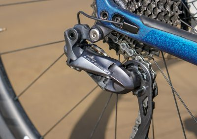 Shimano's Ultegra Di2 functions identically to Dura-Ace Di2. Without a scale - or your wallet - you cannot tell a difference
